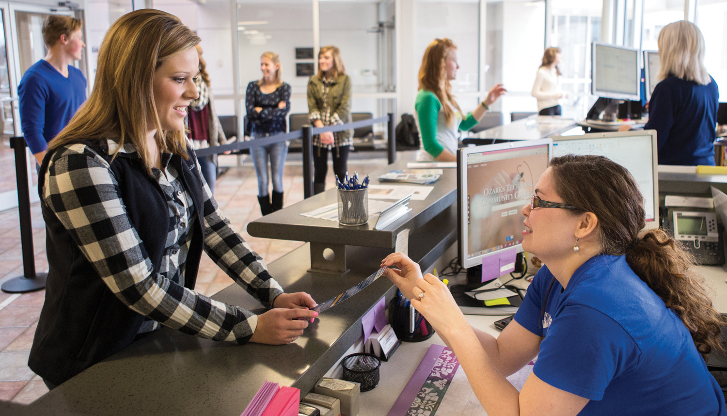 Student receiving assistance at the OTC Student Services counter